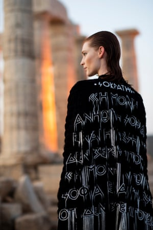 """Katrantzou said she was grateful to her home country for teaching her the importance of the word 'idea'. She explained that she constructed pieces with writing on them so that they bounced and palpitated as they were presented on the catwalk. """"To feel more than a t-shirt slogan; to have their own life,"""" she said."""