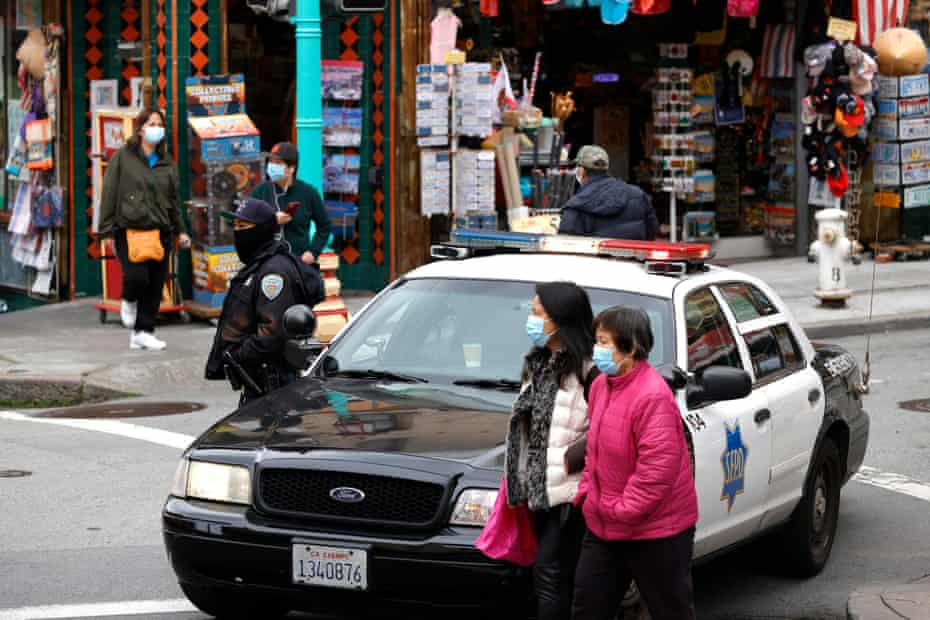 A San Francisco police officer stands guard on Grant Avenue in Chinatown on Wednesday.