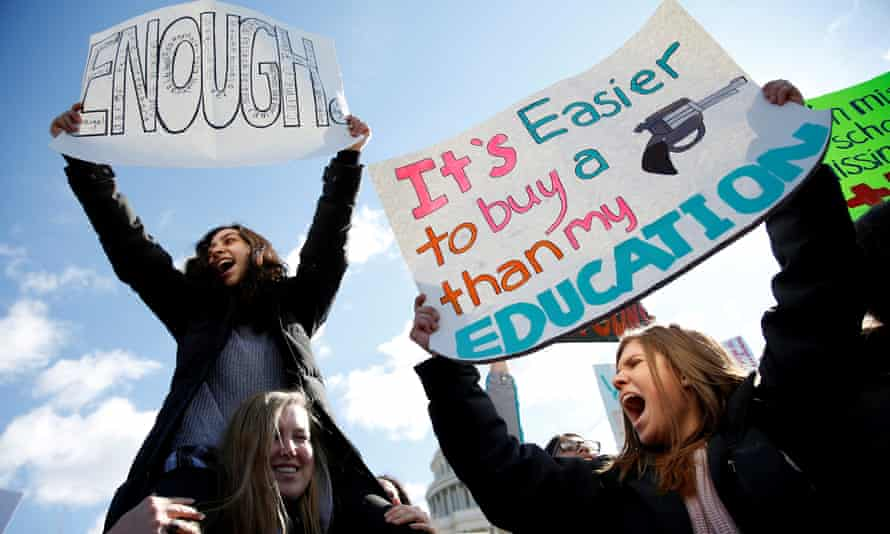 Students from Washington DC-area schools protest for stricter gun control during a walkout on 14 March.
