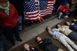 Student demonstrators lie on the ground outside the White House.