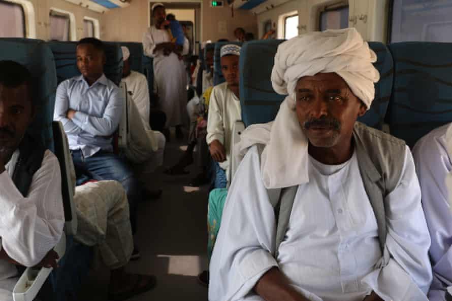 Abdelhalim Tayeb (right) riding the train from Khartoum to Atbara
