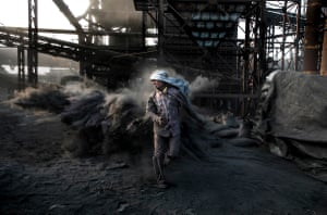 This shot sums up the life of a boy who begins dirty and dangerous work in a coal mine, walking through coal dust, risking danger from pollution and unsafe working practises.