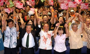 Denny Tamaki (C) celebrates with his supporters after winning the Okinawan gubernatorial elections