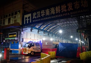 The Wuhan hygiene emergency response team leave the closed Huanan seafood wholesale market on 11 January 11.