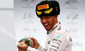 Lewis Hamilton sprays champagne on the podium knowing he is close to sealing his third world title.