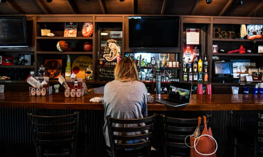 A customer sits at the bar in a restaurant in Atlanta, Georgia, on 27 April.