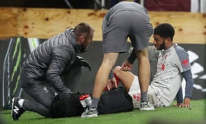 Liverpool's Joe Gomez receives medical attention after sustaining his injury in the 3-1 win at Burnley