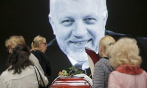 An image of Pavel Sheremet is displayed behind his coffin in Kiev