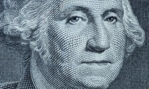 George Washington's portrait on a $1 bill.