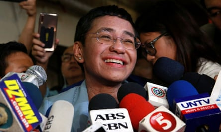 Maria Ressa, the CEO of online news platform Rappler, speaks to the media after posting bail at a Manila court.