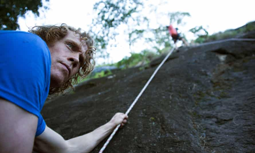 Julian Lines, left, and Mike Robertson, up the rope, prepare the way for the team to move up into Mount Lico's mountaintop forest.