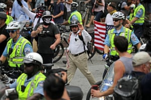 Police guard far-right marchers as they head towards the White House
