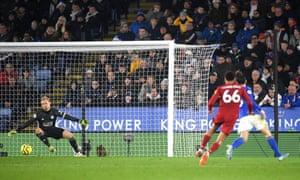 Trent Alexander-Arnold drills a shot beyond Kasper Schmeichel for Liverpool's fourth goal.