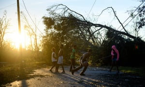 Children play near downed trees and power lines in the aftermath of Hurricane Michael in Panama City, Florida on 11 October 2018.