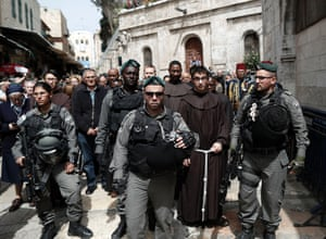 Police officers escort Franciscan priests along the Via Dolorosa (Way of Suffering) in Jerusalem's Old City, Israel