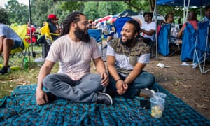 (From left) Wil (cq) Bryant and husband Jonathan Bryant spend time together at the Pure Heat Community Festival at Piedmont Park in Atlanta, Ga. on 2 Sept. 2018. The festival is the largest event of Atlanta Black Pride weekend. Photograph: Bita Honarvar © 2018 Bita Honarvar