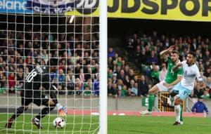 Northern Ireland's Stuart Dallas scores his side's second goal.