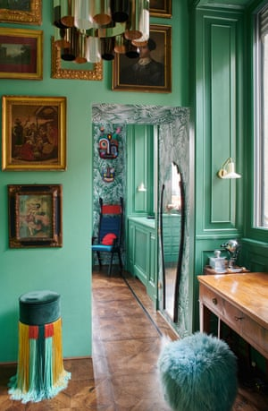Playing to the gallery: sumptuous green walls are lined with paintings in contrasting gilt frames.