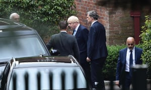 Boris Johnson leaving Stormont House with Northern Ireland secretary Julian Smith following their talks with the five main Northern Ireland parties.