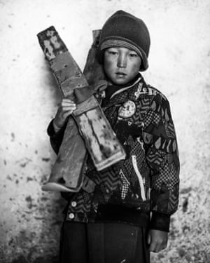 3rd Place: Portraiture category - from the series 'High Water'Omid, who doesn't know his age, stands for a portrait with his homemade skis in Aub Bala's village mosque.