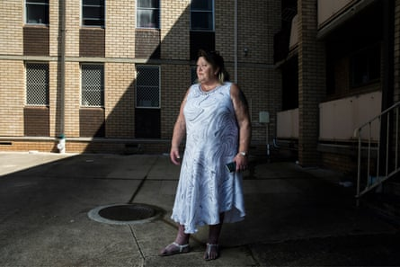 Frances Drake outside a public housing block of apartments in Liverpool