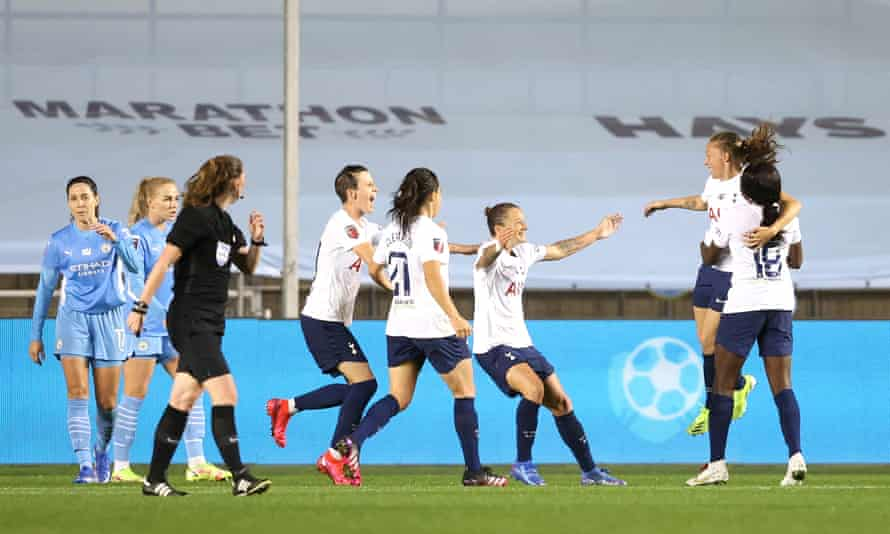 Tottenham celebrate their second goal against Manchester City at the Academy Stadium.