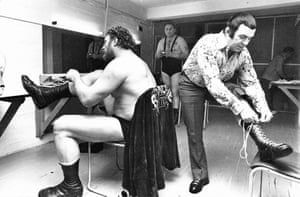 Fake feuds – and genuine animosity – between wrestlers was commonplace, but away from the ring, many were good friends. In this rare peek back stage, we find Pat Roach (who would later appear as the moustachioed bald headed man threatening to fight Harrison Ford in Indiana Jones) and Mick McManus amiably preparing for the night's action.