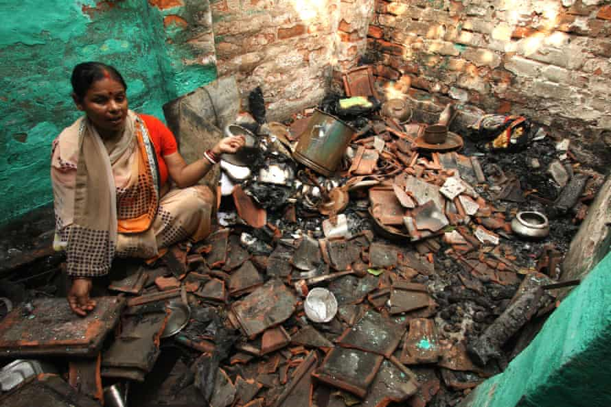 Kanchan Chowdhury, a Hindu woman, sitting inside her kitchen that was destroyed in an attack by a Muslim mob. Hours after a Hindu mob destroyed a Muslim locality in a fire and bomb attack, some Muslims attacked a few Hindu households in a retaliatory attack.