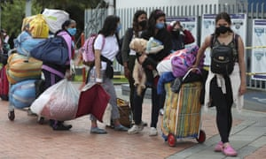 Migrants in Bogotá wait for a bus to take them to the Venezuelan border, Thursday, 2 July 2020.