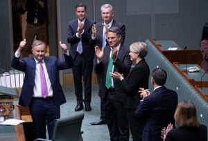 Anthony Albanese and Labor colleagues after making his budget reply speech