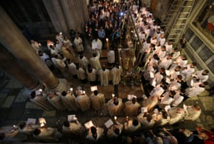 Christian worshippers take part in a Sunday Easter mass procession in the Church of the Holy Sepulchre in Jerusalem's Old City