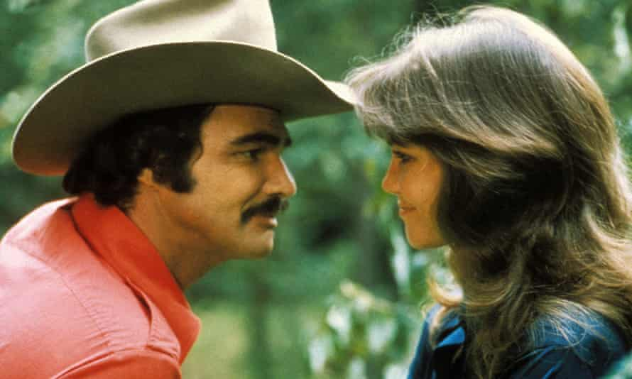 Reynolds with Sally Field in Smokey and The Bandit.