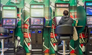 a woman bets on an FOBT