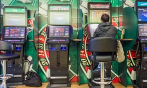 Fixed-odds betting terminals at a betting shop.