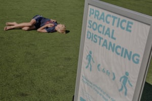 Signs advise social distancing at Pier 25 in Manhattan on Thursday 14 May