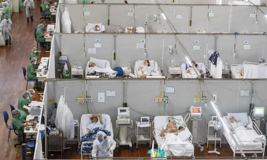 Coronavirus patients in a field hospital set up inside a sports coliseum in Santo Andre, on the outskirt of São Paulo, Brazil, on 4 March.