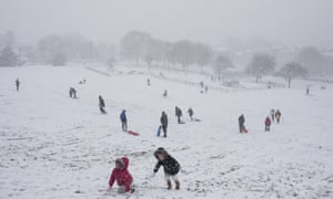 People use their sleds in the snow in Jackson's Fields in Rochester. Schools have been closed throughout the country