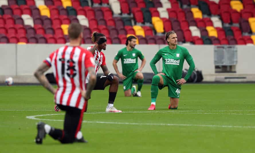 Brentford and Preston players take the knee before the Championship match at the Brentford Community Stadium in October.