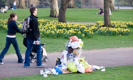 Overflowing litter bin in a London park