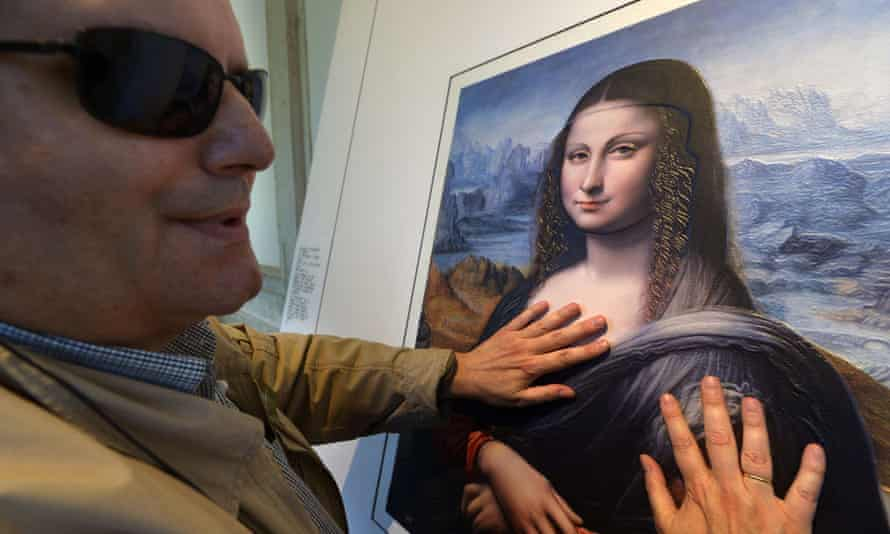 Jose Pedro Gonzalez, a 56-year-old blind visitor to the Prado museum, touches a contemporaneous copy of the Mona Lisa.