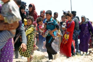 Families flee the besieged city, following a series of airstrikes targeting Isis positions