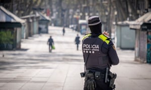 A police officer is seen on duty on the Ramblas in Barcelona.