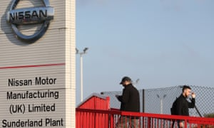 Workers leave the Nissan car plant