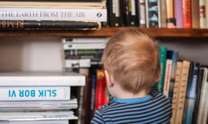 Ideal home … a child looks at some of the books on the family shelves.
