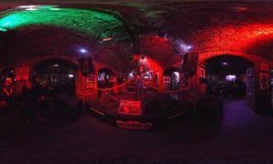 A musician singing to tourists in the Cavern Club where The Beatles played in their early years