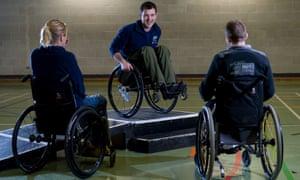 Tim Rushby-Smith (centre) teaching wheelchair skills.