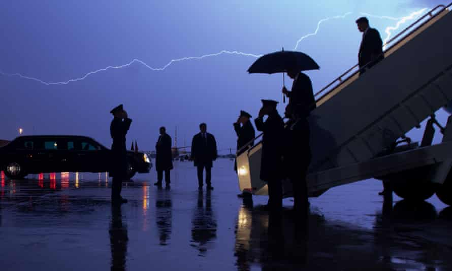 Donald Trump disembarks Air Force One as lightning splits the sky at Joint Base Andrews in Maryland, in August 2020.