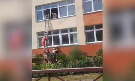 Video appears to show Belarus official climbing down ladder with bag thought to contain voting slips
