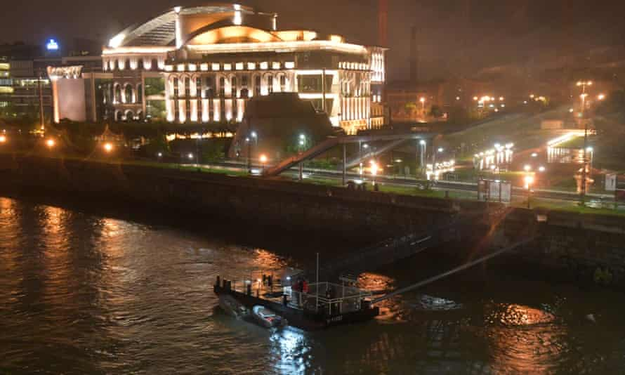 Rescue boats search the river for South Korean tourists missing after their boat sank, following a collision.