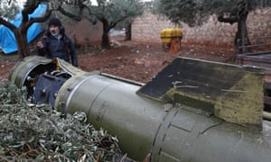 The remains of a missile fired by Syrian forces in a field in the town of Sarmin